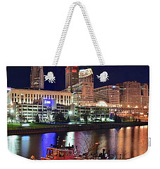 Weekender Tote Bag featuring the photograph Cleveland And Tug Boats by Frozen in Time Fine Art Photography