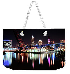 Weekender Tote Bag featuring the photograph Cleveland Ohio Lights Up With Color by Frozen in Time Fine Art Photography