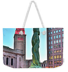 Weekender Tote Bag featuring the photograph Cleveland Statue Sunset by Frozen in Time Fine Art Photography