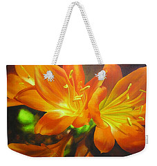 Weekender Tote Bag featuring the painting Clivias by Chris Hobel