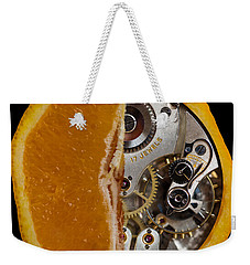 Weekender Tote Bag featuring the photograph Clockwork Orange by Brian Roscorla