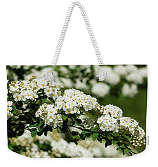 Weekender Tote Bag featuring the photograph Close-up White Spirea Bush by Cristina Stefan