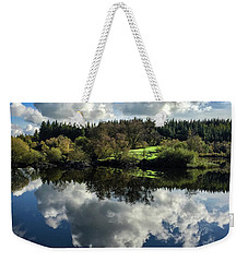Weekender Tote Bag featuring the photograph Clouded Visions by Geoff Smith
