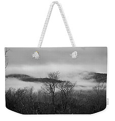 Weekender Tote Bag featuring the photograph Clouds Above And Below by Michael Friedman