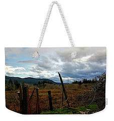 Weekender Tote Bag featuring the photograph Clouds And Field by Chriss Pagani