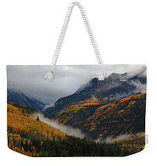 Weekender Tote Bag featuring the photograph Clouds And Fog Encompass Autumn At Mcclure Pass In Colorado by Jetson Nguyen