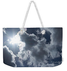 Weekender Tote Bag featuring the photograph Clouds And Sunlight by Megan Dirsa-DuBois
