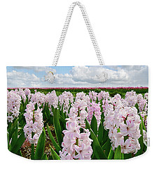 Clouds Over The Pink Hyacinth Field Weekender Tote Bag by Mihaela Pater