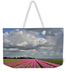 Clouds Over The Purple Tulip Field Weekender Tote Bag by Mihaela Pater