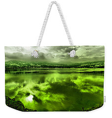 Weekender Tote Bag featuring the photograph Clouds Reflecting Off The Columbia  by Jeff Swan
