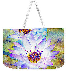 Cloudy Blue Lilies Weekender Tote Bag by Janet Immordino