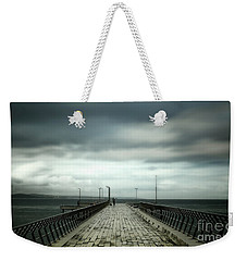 Weekender Tote Bag featuring the photograph Cloudy Pier by Perry Webster