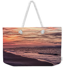 Weekender Tote Bag featuring the photograph Cloudy Sunrise At The Beach by John McGraw