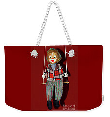 Weekender Tote Bag featuring the photograph Clown On Swing By Kaye Menner by Kaye Menner