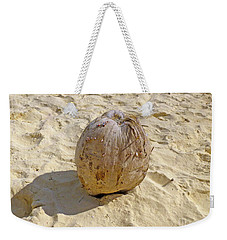 Weekender Tote Bag featuring the photograph Coconut In The Sand by Francesca Mackenney
