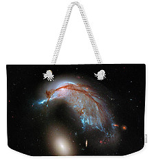 Weekender Tote Bag featuring the photograph Colliding Galaxy by Marco Oliveira