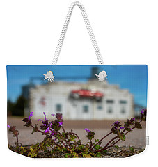 Weekender Tote Bag featuring the photograph Collyer Sidewalk Blooms by Darren White