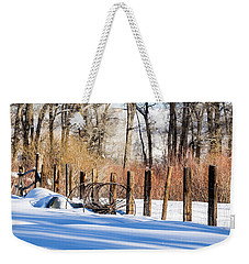 Weekender Tote Bag featuring the photograph Colorado Winter Snow Scene With Old Farming Rake And Rustic Fence by Nadja Rider
