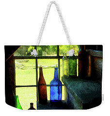 Weekender Tote Bag featuring the photograph Colored Bottles On Steps by Susan Savad