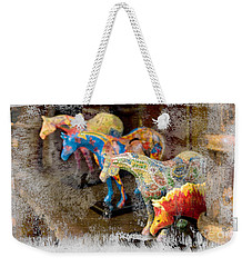 Weekender Tote Bag featuring the photograph Colored Horses. by Andrey  Godyaykin