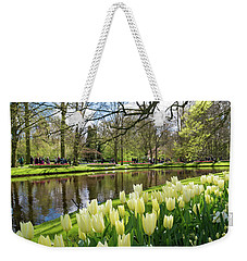 Weekender Tote Bag featuring the photograph Colorful Blooming Tulips by Hans Engbers