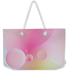 Weekender Tote Bag featuring the photograph Colorful Bubbles by Elena Nosyreva