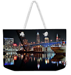 Weekender Tote Bag featuring the photograph Colorful Cleveland Flats by Frozen in Time Fine Art Photography