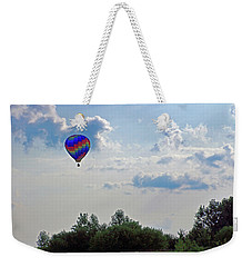 Weekender Tote Bag featuring the photograph Colorful Hot Air Balloon by Angela Murdock