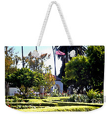 Weekender Tote Bag featuring the photograph Colors In The Garden by Glenn McCarthy Art and Photography
