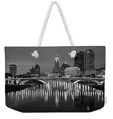 Weekender Tote Bag featuring the photograph Columbus Ohio Skyline At Night Black And White by Adam Romanowicz