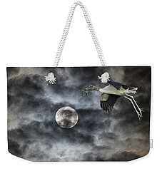Weekender Tote Bag featuring the photograph Coming Home by Richard Goldman