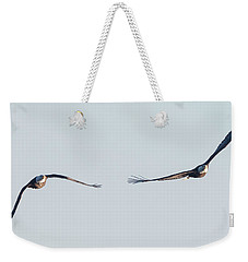Weekender Tote Bag featuring the photograph Coming Right At You - Two Bald Eagles by Ricky L Jones