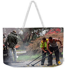 Young Male Construction Workers At Work Paving Road Weekender Tote Bag