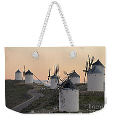 Weekender Tote Bag featuring the photograph Consuegra Windmills by Heiko Koehrer-Wagner