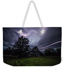 Weekender Tote Bag featuring the photograph Convergence  by Aaron J Groen