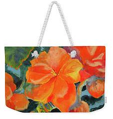 Weekender Tote Bag featuring the painting Coral Begonias by Kathy Braud