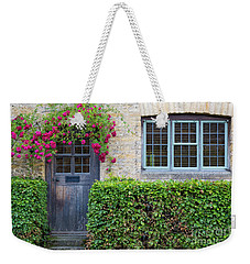 Weekender Tote Bag featuring the photograph Cotswolds Cottage Home by Brian Jannsen