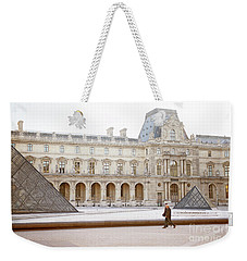 Weekender Tote Bag featuring the photograph Couple Strolling At Louvre Museum  by Ivy Ho
