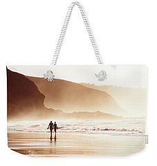 Couple Walking On Beach With Fog Weekender Tote Bag
