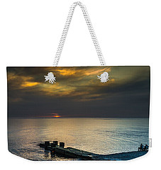 Weekender Tote Bag featuring the photograph Couple Watching Sunset by John Williams