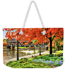 Weekender Tote Bag featuring the painting Covered Bridge Along Riverwalk by Christopher Arndt
