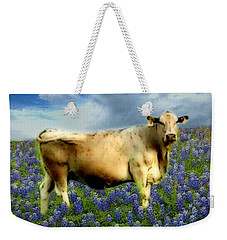 Weekender Tote Bag featuring the photograph Cow And Bluebonnets by Barbara Tristan