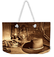 Cowboy Hat And Kerosene Lanterns Weekender Tote Bag by American West Legend By Olivier Le Queinec