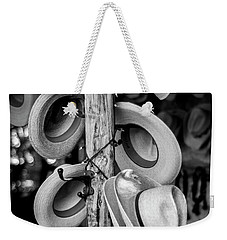 Weekender Tote Bag featuring the photograph Cowboy Hats At Snail Creek Hat Company by David Morefield