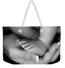 Weekender Tote Bag featuring the photograph Cradled by Angela Rath