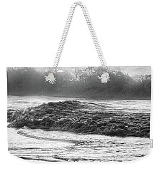 Weekender Tote Bag featuring the photograph Crashing Wave At Beach Black And White  by John McGraw