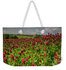Weekender Tote Bag featuring the photograph Crimson Clover Patch by Barbara Bowen