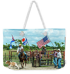 Weekender Tote Bag featuring the photograph Cuban Cowboys by Lou Novick