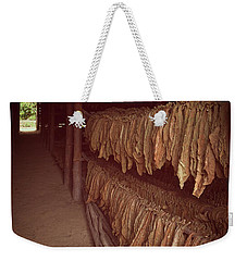 Weekender Tote Bag featuring the photograph Cuban Tobacco Shed by Joan Carroll