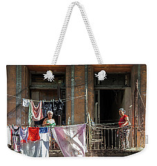 Weekender Tote Bag featuring the photograph Cuban Women Hanging Laundry In Havana Cuba by Charles Harden